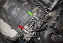 On R56 MINI models, the intake (inlet) camshaft sensor is located on the left rear of the cylinder head (green arrow).