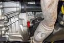 The crankshaft position sensor (red arrow) is located below the starter motor, mounted in the engine block.