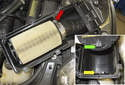 Flip the intake air-housing lid over to expose the air filter.