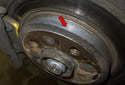 Most factory rotors and some aftermarket rotors will have a minimum thickness stamped (red arrow) on the rotor.