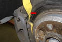 It is also a good idea to measure your brake pad thickness (red arrow).