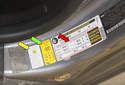 Tire pressure information for your vehicle is located in the driver doorjamb on the tire info label (red arrow) shown in this photo.