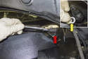 Once you have marked the arm, remove the 13mm pivot nut (red arrow).