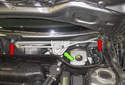 Working at the wiper motor transmission, remove the 13mm center fastener (green arrow) and the two 10mm Torx fasteners (red arrows).