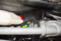 Lift the wiper assembly up and slide it out of the cowl far enough to access the electrical connector.