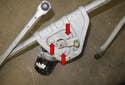 Next, remove the three T30 Torx wiper motor fasteners (red arrows).
