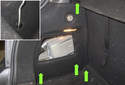 Working at the left inner cargo area, remove the four plastic rivets (green arrows).