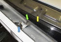 This photo shows the alignment pin (green arrow) and plastic anchor (yellow arrow).