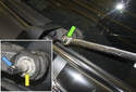 Next, remove the 13mm wiper arm nut (green arrow).