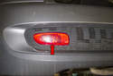 Rear Fog Light: The rear fog lights are mounted in the lower rear bumper cover (red arrow).