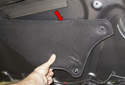 Slide the insulation panel down (red arrow) to remove it from the hood.