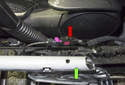 With the center console removed, disconnect the coaxial connector next to the parking brake lever (green arrow).