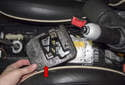 Remove the foam protective block (red arrow) from the top of the airbag control module.