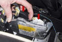 Lift the airbag module up to access the electrical connector at the right side.