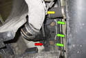 Unclip and remove the wiring harnesses from the trailing arm.