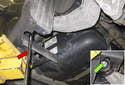Next, loosen the 20mm bracket fastener (green arrow).