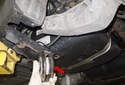 Then remove the bracket (red arrow) from the trailing arm.