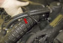 Next, install the hoses and recheck the clearance to the intake duct (red arrow).