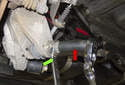 Lower control arm: Loosen the 16mm fastener (red arrow) while counter-holding the 24mm 12 point adjuster (green arrow).