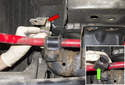 Remove the sway bar bushing bracket (red arrow).