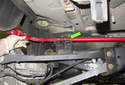 To replace the sway bar, lift the sway bar up and remove it through the gap between the subframe and body (green arrow).