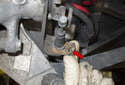 Then, remove the cable-locking clip (red arrow).