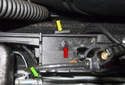 Next, disconnect the electrical connector next to the parking brake lever (green arrow).