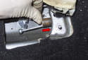 Press a small pipe (red arrow), over the cable until flush.