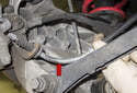 Pull the cable out of the caliper bracket (red arrow).