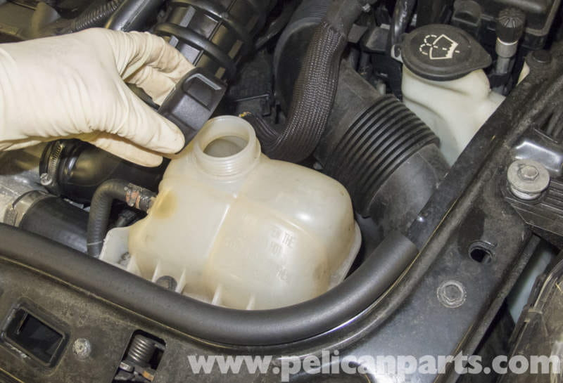 draining cooling system: working in the engine compartment, remove the  expansion tank cap