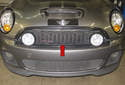 The radiator grille (red arrow) is mounted in the radiator support above the front bumper cover.
