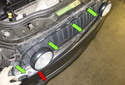 Next, remove the lower grille trim (red arrow).
