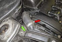 Turbocharged models: Loosen the charge air duct hose clamp (red arrow).