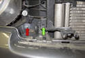 If you have the optional bumper driving lights, you need to remove the light-mounting bracket.