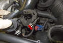 Remove the auxiliary coolant pump from the engine (red arrow).