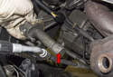 Remove the drive belt tensioner (red arrow) from the engine.