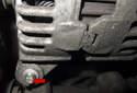 Remove the lower E10 external Torx (red arrow) alternator fastener.