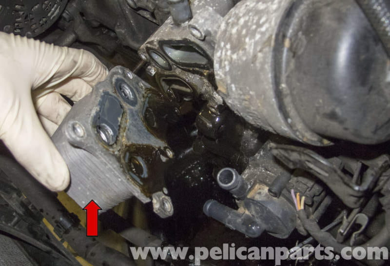 how to clean excess oil off lawnmower engine