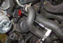 Follow the coolant hose from the front of the turbocharger to the side of the cylinder head.