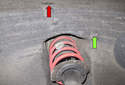 Front liner: Next, at the top of the liner, remove the Phillips head plastic screw (red arrow).