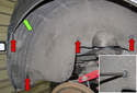Rear liner: Working at the rear of the liner, remove the four Phillips head plastic screws (red arrows).