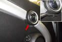 Working at the inner door handle, remove the plastic rivet (red arrow).