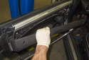 Lift the door panel up and off the lock rod and remove it from the door.