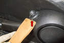 Use a plastic prying tool and lever the power window switch out of the door pane (red arrow).