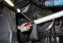 Next, unclip the line (red arrow) and remove the support from the engine.