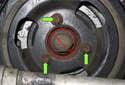 Remove the three E10 external Torx fasteners (green arrows).