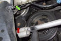 The water pump (green arrow) mounts to the right side of the engine block and is sealed with a rubber profile gasket.