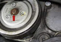 The pulley is usually stuck due to rust on the water pump flange (red arrow).