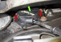 With the wheel well liner removed, you can see the friction wheel fasteners.