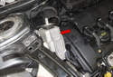 Lift the mount (red arrow) out of the engine bay and remove it.